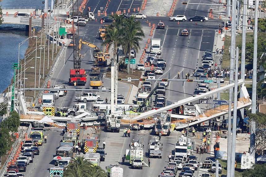 An aerial view shows a pedestrian bridge collapsed at Florida International University in Miami.
