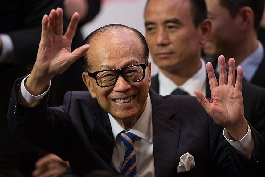 Mr Li Ka Shing leaving a packed news conference in Hong Kong after his announcement yesterday. His retirement remarks came on a high note as Mr Li's four biggest companies - CK Hutchison, CK Asset, CK Infrastructure Holdings and Power Assets Holdings