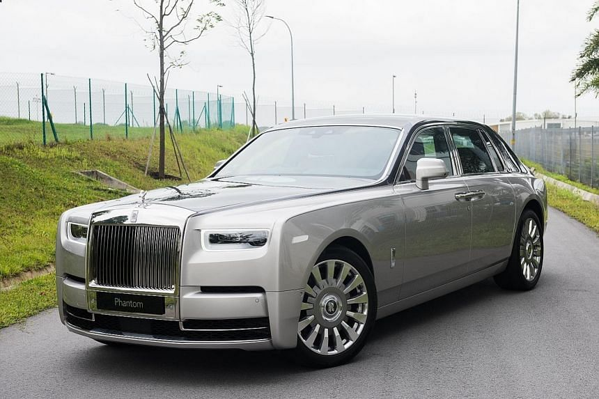 The Rolls-Royce Phantom comes with a glass-encased display (above) where owners can mount artefacts. The luxurious Rolls-Royce Phantom glides around corners with the ease of a car half its size.