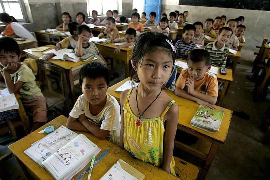 "Pupils in a Hainan school. Improving the quality of education is a pillar of China's plans for ""national rejuvenation"" and seen as a key to lifting millions out of poverty and transforming the nation into a country of innovators."