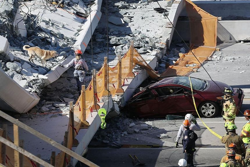 Right: At least eight cars were trapped when the 950-tonne concrete bridge suddenly gave way. Far right: Rescue workers searching the rubble and trying to detect signs of life with listening devices, fibre optics and dogs.