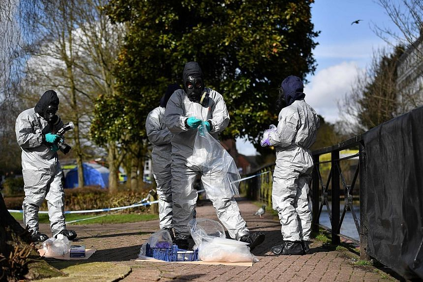 Left: Workers swabbing railings and bagging samples in Salisbury, where the Russian spy and his daughter were found unconscious. Above: When asked if Russia planned to expel British diplomats from Moscow, Russian Foreign Minister Sergei Lavrov said: