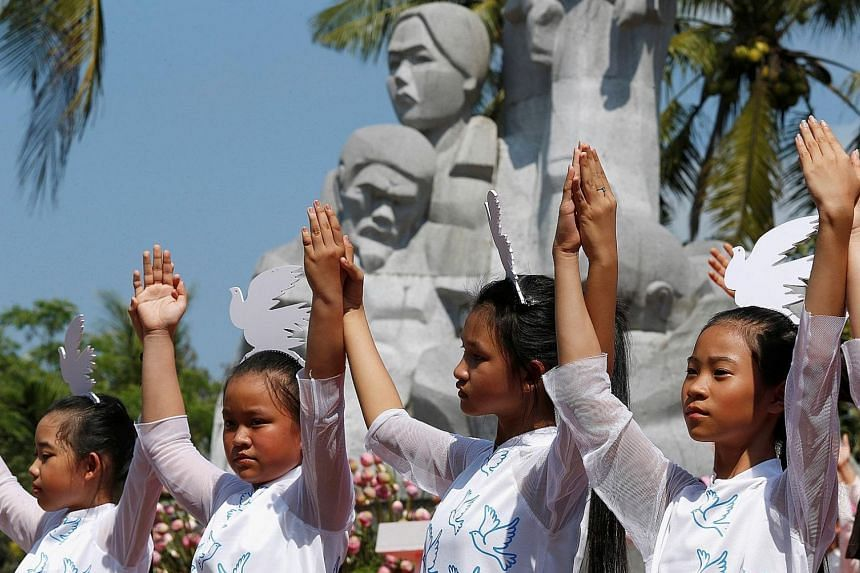 Schoolgirls at yesterday's ceremony marking the My Lai massacre, where American soldiers killed 504 people in Son My, a collection of hamlets between the central Vietnamese coast and a ridge of mountains.