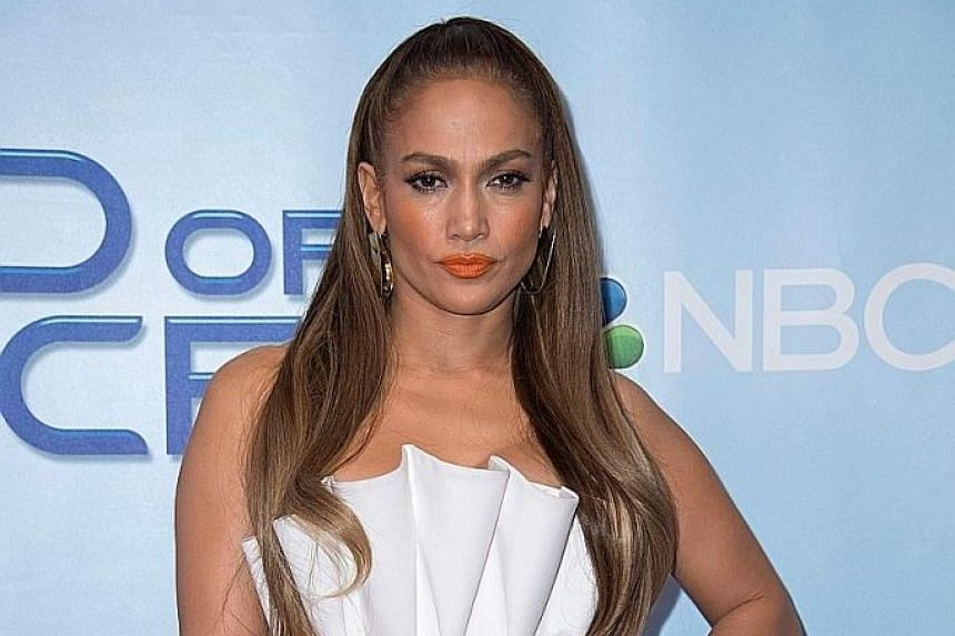 Singer-actress Jennifer Lopez says she was asked to expose her breasts early in her career.