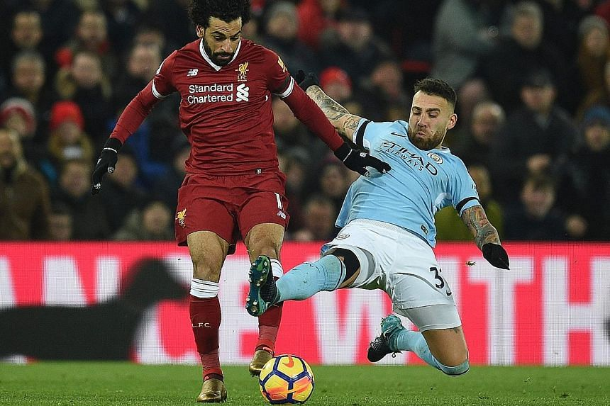 Manchester City defender Nicolas Otamendi (right) tackling Liverpool forward Mohamed Salah during the 4-3 Premier League home win for the Reds in January.