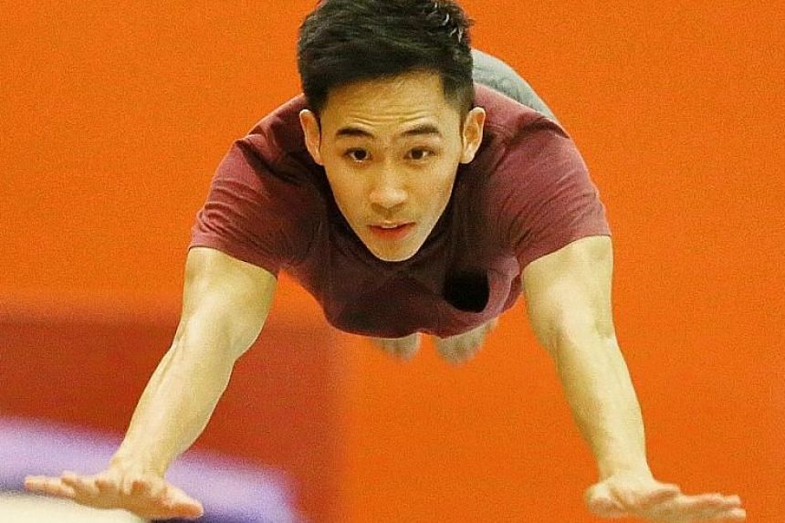 Hoe Wah Toon springing onto the vault during training at the CCAB gymnastics hall for next month's Commonwealth Games, for which he has qualified in the vault and floor.