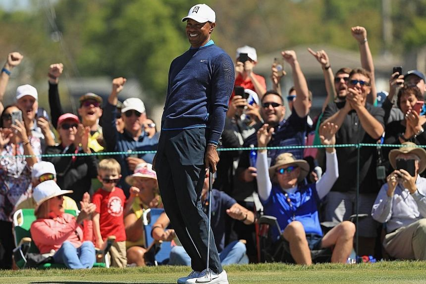 Tiger Woods and fans reacting to his birdie putt on the seventh hole during his first-round 68 at the Arnold Palmer Invitational at Bay Hill, Florida, on Thursday.