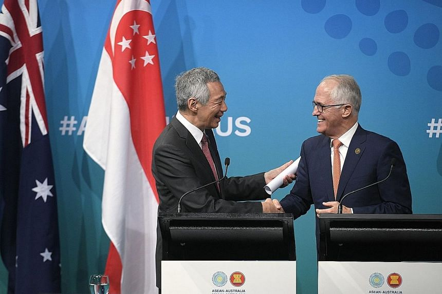Prime Minister Lee Hsien Loong and Australian Prime Minister Malcolm Turnbull at a joint press conference at the Singapore-Australia Leaders' Summit yesterday.