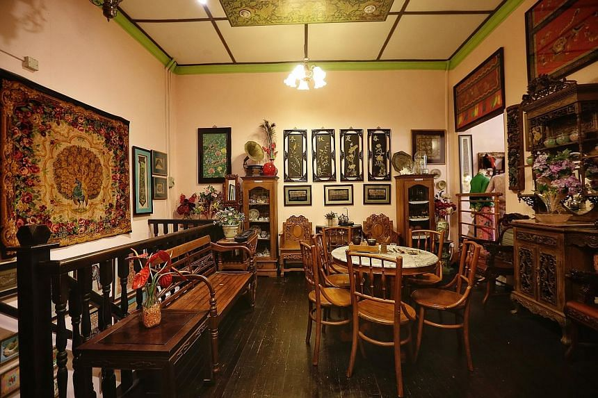Brothers Raymond (left) and Edmond Wong at the Rumah Kim Choo shophouse in East Coast Road, which is filled with antiques and family heirlooms (above and below).