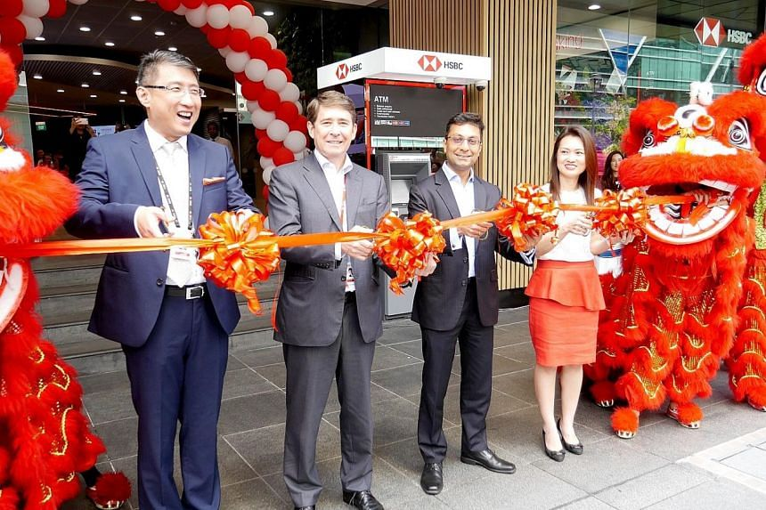 At HSBC's new Raffles Place branch opening are (from left): Mr Chriz Lim, branch director; Mr Tony Cripps, CEO, HSBC Singapore; Mr Anurag Mathur, head of Retail Banking and Wealth Management; and Ms Fion Khoh, head of Network.