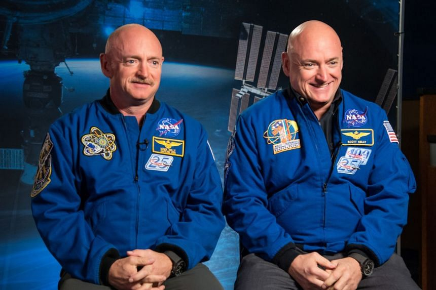Identical twin astronauts, Scott (right) and Mark Kelly, are subjects of Nasa's Twins Study. Scott spent a year in space while Mark stayed on Earth as a control subject.