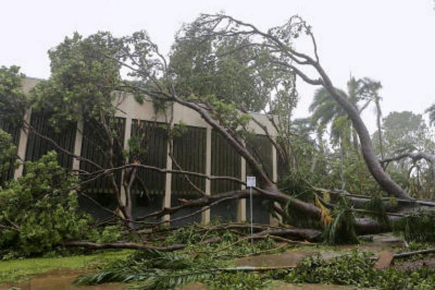 A tree that was uprooted due to winds from Tropical Cyclone Marcus lies on a building in the Northen Territory capital city of Darwin in Australia on March 17, 2018.