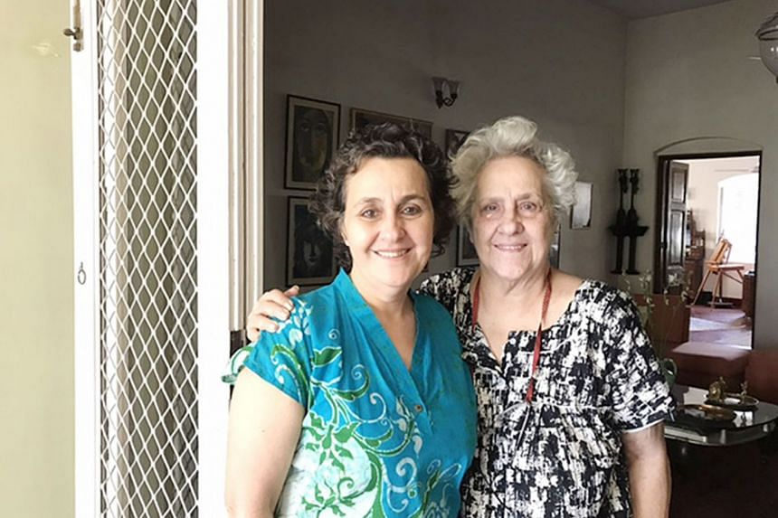 Above: The Jewish cemetery in Kolkata. There are only about 20 Jews living in the city now. Left: Historian Jael Silliman and her mother, Mrs Flower Silliman, in their home in Kolkata.