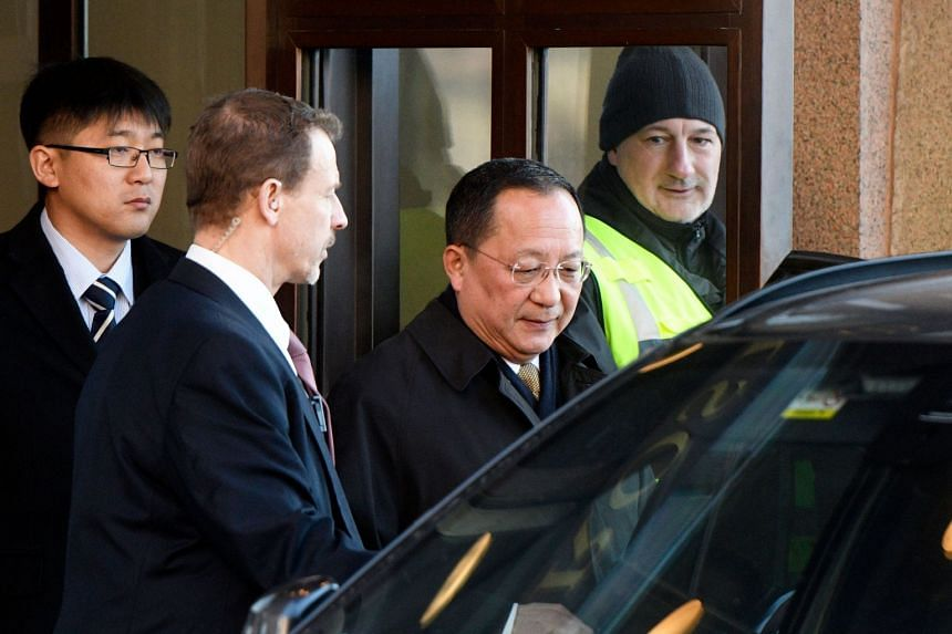 North Korean Foreign Minister Ri Yong Ho (centre) leaves the Swedish government building Rosenbad in central Stockholm on March 16, 2018.