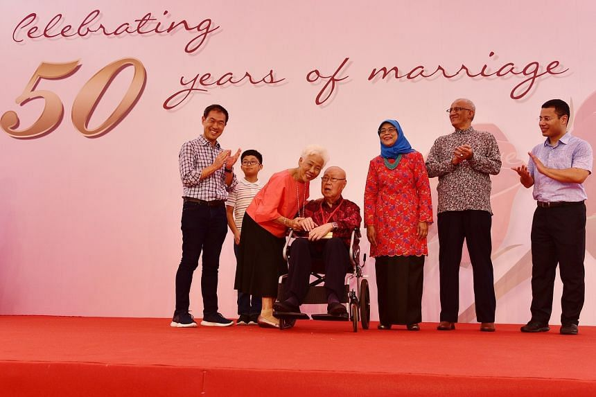 (From left) Mr Andrew Chew, his son Benjamin, Madam Cheong Geok Pang and Mr Chew Eng Hwa pose for a photo onstage with President Halimah Yacob; Mr Mohammed Abdullah Alhabshee and Minister for Social and Family Development Desmond Lee.