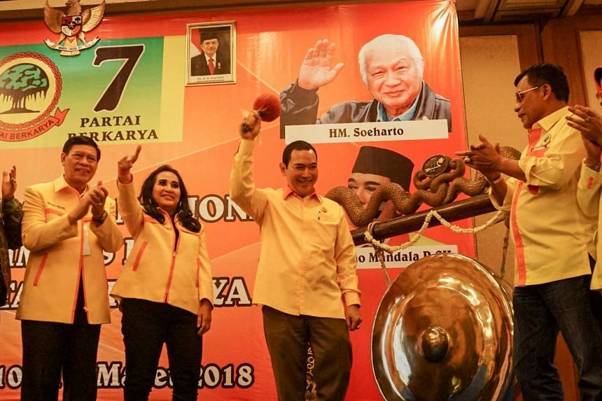 "Hutomo ""Tommy"" Mandala Putra, (centre) hits the gong at the opening of the Berkarya (Working) Party national meeting where he was voted chairman, in Solo, Central Java, on March 10, 2018."