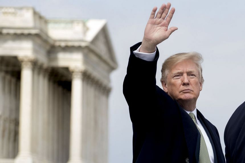 Trump waves to members of the news media at the US Capitol in Washington, March 15, 2018.
