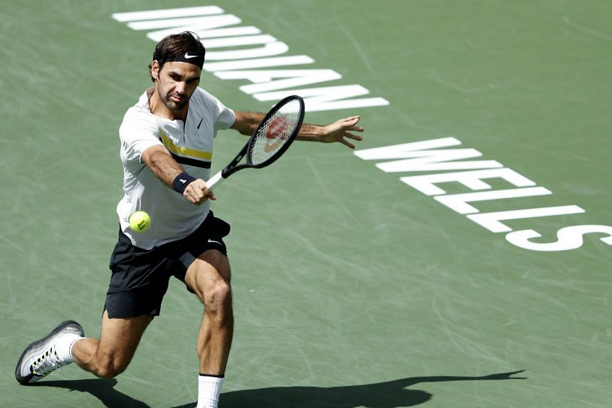 Federer in action against Borna Coric of Croatia during the BNP Paribas Open.
