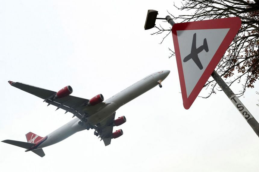 A file photo shows a Virgin Atlantic aircraft landing at Heathrow airport in west London.