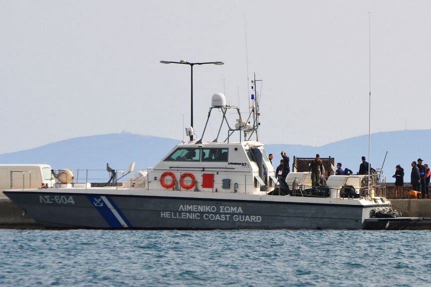 A Hellenic Coast Guard vessel carrying the bodies of the migrants is moored at Samos island in Greece.