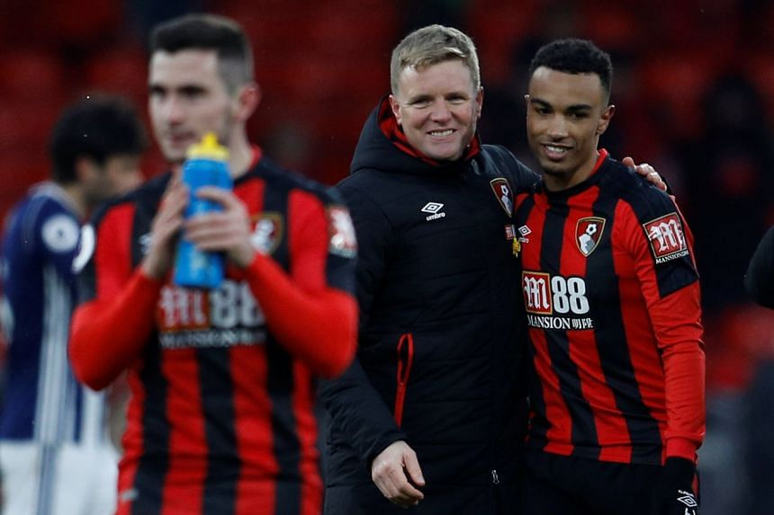 Bournemouth manager Eddie Howe and Bournemouth's Junior Stanislas after the match.