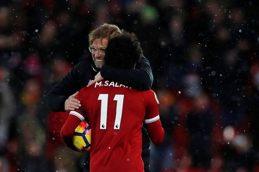 Liverpool's Mohamed Salah celebrates with manager Juergen Klopp after the match.