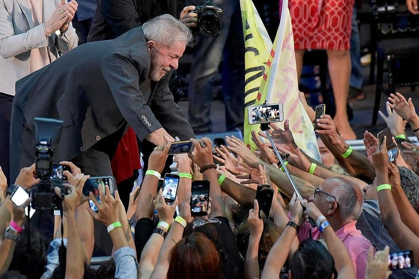 Mr Luiz Inacio Lula da Silva greeting supporters at a rally in Belo Horizonte, Brazil, on Feb 21. Mr da Silva is a frontrunner in the presidential polls and also reportedly the leading target of negative fake news stories.