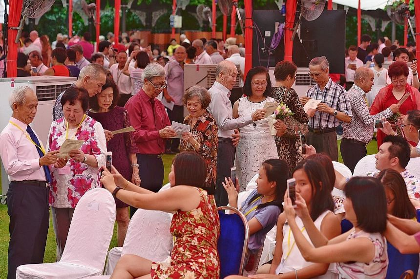 Senior couples reciting a love declaration in front of guests at the Golden Jubilee Wedding Celebrations at the Istana yesterday. President Halimah Yacob was the guest of honour at the event.