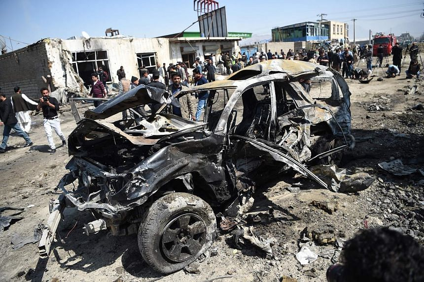 A Taleban suicide attacker blew up a bomb-laden car in Kabul during rush hour yesterday, killing at least two civilians.