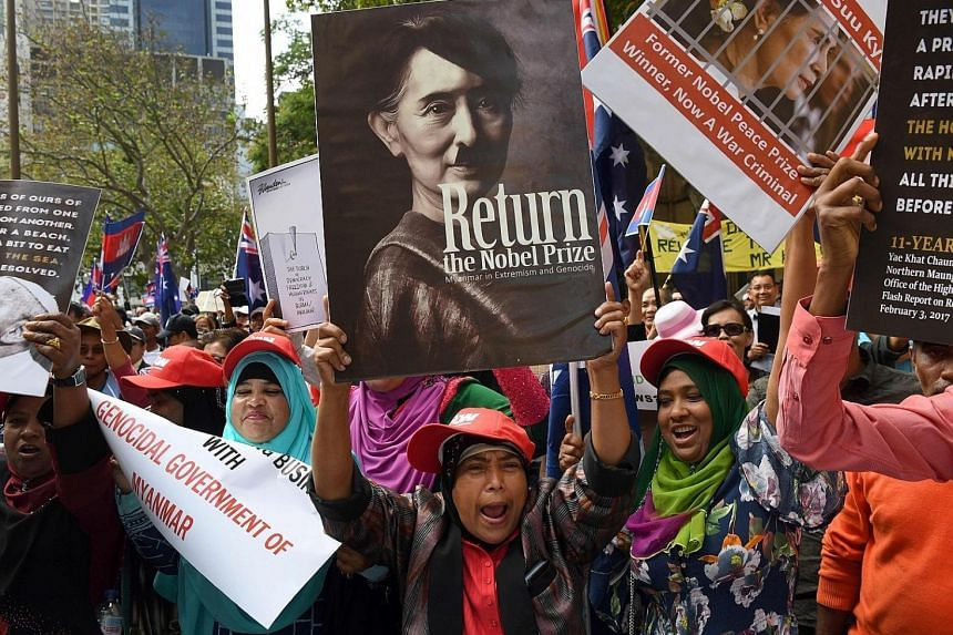 Protesters demonstrating against Myanmar's de facto leader Aung San Suu Kyi at the Asean-Australia summit in Sydney yesterday. Cambodian Prime Minister Hun Sen was among other leaders targeted.