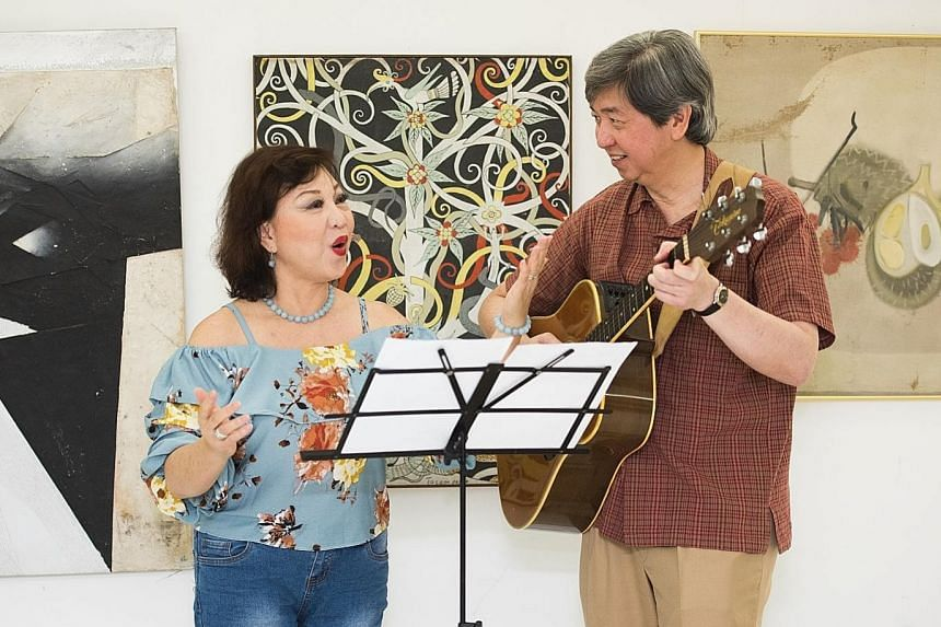 Madam Susan Teo gained confidence in singing under vocal coach Desmond Moey (both left).