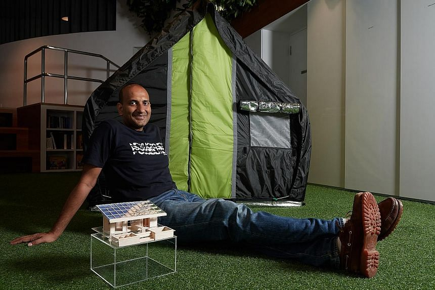 Mr Prasoon on a visit to Diggi Tanda village in India. billionBricks has worked on about eight projects and settled at least 4,000 homeless in several countries. Mr Prasoon Kumar at his office in Fusionopolis, with the all-season weatherHYDE tent tha