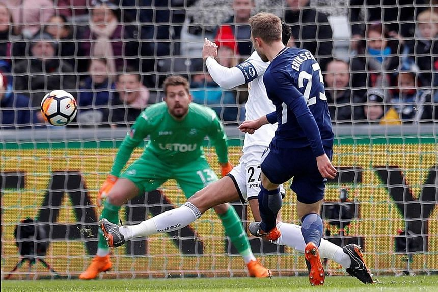 Tottenham's Christian Eriksen scoring the opening goal in the 3-0 FA Cup quarter-final win at Swansea's Liberty Stadium yesterday. Spurs will play the semi-final at their temporary home of Wembley next month.