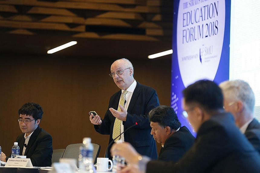 """From left: Singapore Management University law dean Goh Yihan and SMU president Arnoud De Meyer argued against the motion """"You don't need a degree to succeed in life"""" at the Straits Times Education Forum yesterday. On the opposing team were OECD dire"""
