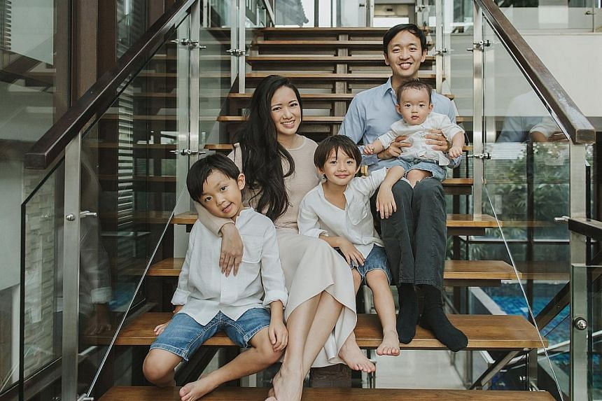 Entrepreneur Elaine Kim with her husband John, and sons (from far left) Kyan, six, Luke, five, and Nate, one. Dr Kim believes that greater business networking support for women, and flexible work schemes can help women get ahead in their careers.