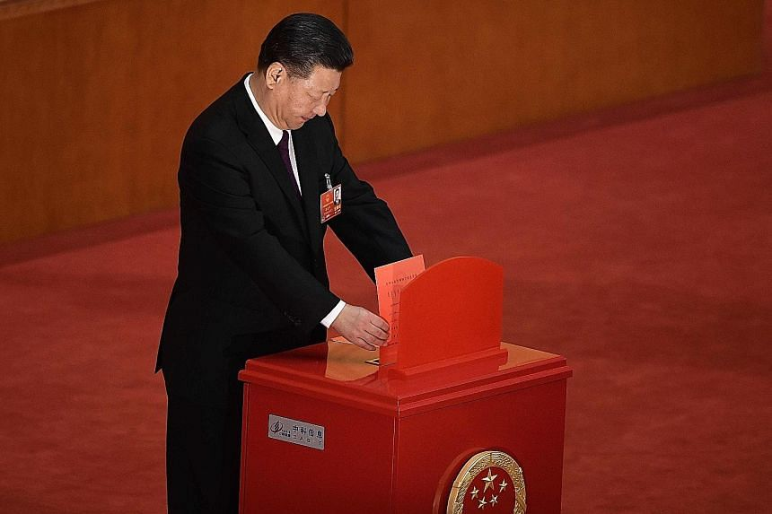 President Xi Jinping casting his vote at the NPC session. He has been unanimously elected to a second term, days after the lifting of presidential term limits allowed him to stay in office indefinitely. Delegates lining up to vote during the fifth pl
