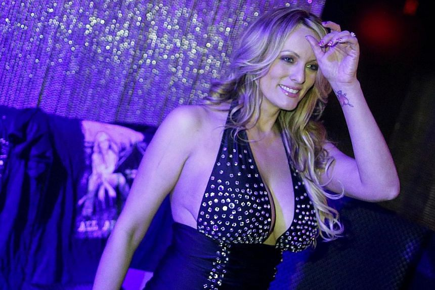 Ms Stephanie Clifford, also known as Stormy Daniels, posing for pictures at the end of a striptease show in Long Island, New York, last month.