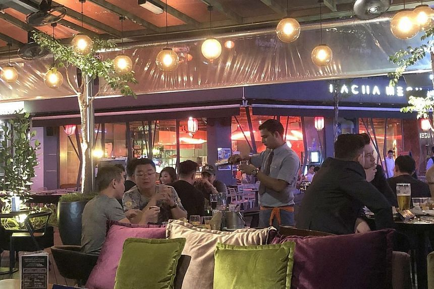 Malaysian law allows restaurants to hire foreign workers as cooks only, not servers or cashiers, though few follow the regulation due to a lack of locals taking up these jobs.
