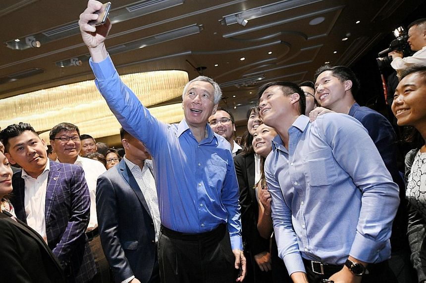 Prime Minister Lee Hsien Loong taking a wefie with Singaporean students in Sydney yesterday, at a reception for overseas Singaporeans held at the Shangri-La Hotel, in conjunction with his visit to Australia to attend the Asean-Australia Special Summi