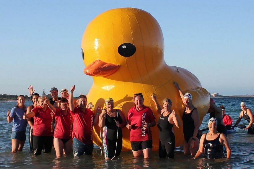 Swimmers from  Perth's Cockburn Masters Swimming Club posing with a giant inflatable duck they named Daphne in Perth.