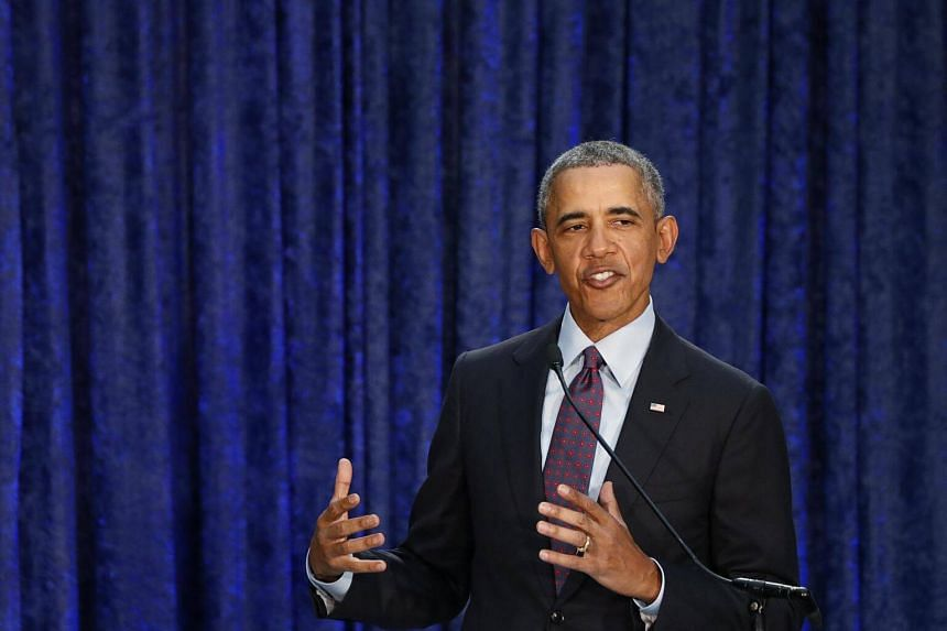 Former US President Barack Obama speaks during an unveiling ceremony for portraits of himself and former First Lady Michelle Obama at the Smithsonian's National Portrait Gallery in Washington.