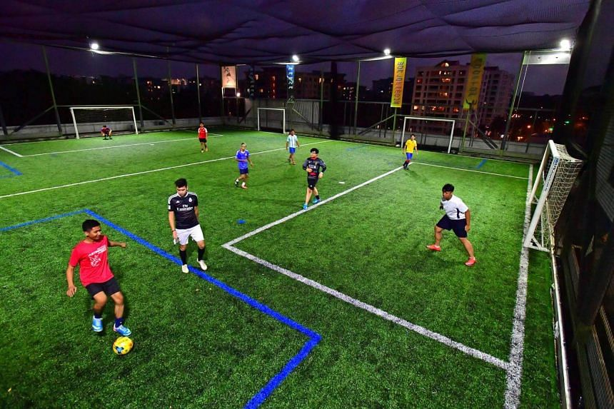 People playing futsal at SkyPark Arena in Bukit Timah.