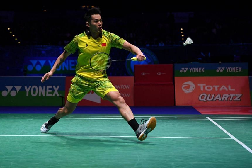 China's Lin Dan plays a shot during his men's semi final match at the All England Open Badminton Championships in Birmingham, on March 17, 2018.