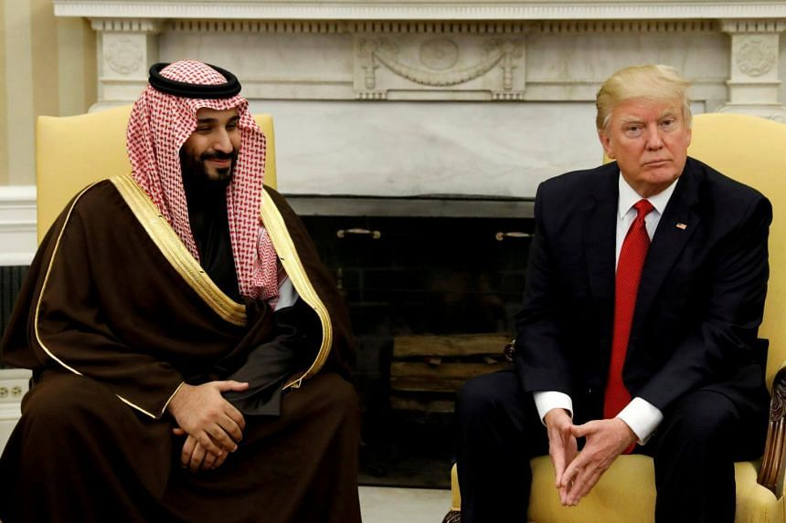 US President Donald Trump with Saudi Arabia's crown prince Mohammed bin Salman in the Oval Office of the White House in Washington on March 14, 2017.