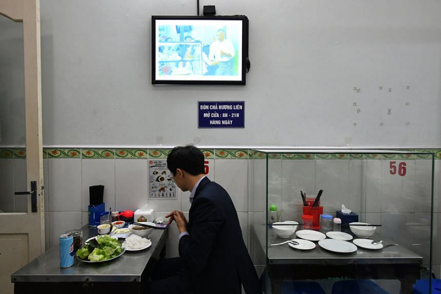A table in a Hanoi street food restaurant that US president Barack Obama and chef Anthony Bourdain had their meal in 2016 has been encased in glass.