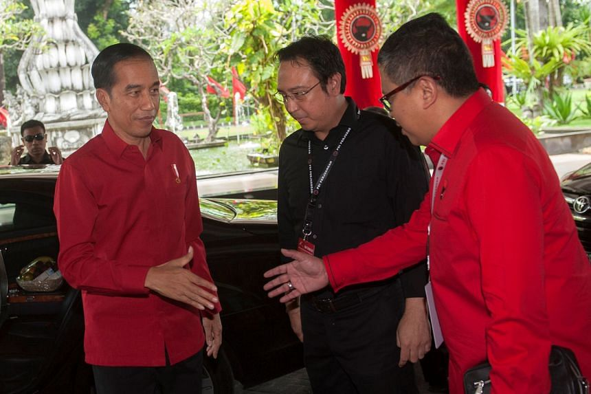 Indonesian President Joko Widodo (left) being greeted by Mr Hasto Kristiyanto, secretary-general of the PDI-P party, last month. Indonesia will have regional elections in June, ahead of a presidential ballot next year.
