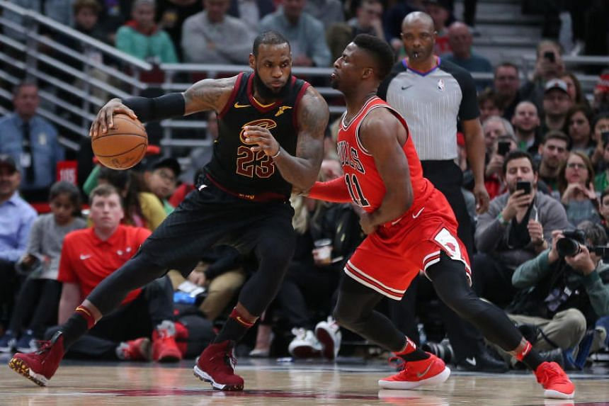 Cleveland Cavaliers forward LeBron James (left) backing down against Chicago Bulls forward David Nwaba during their NBA match on March 17, 2018.