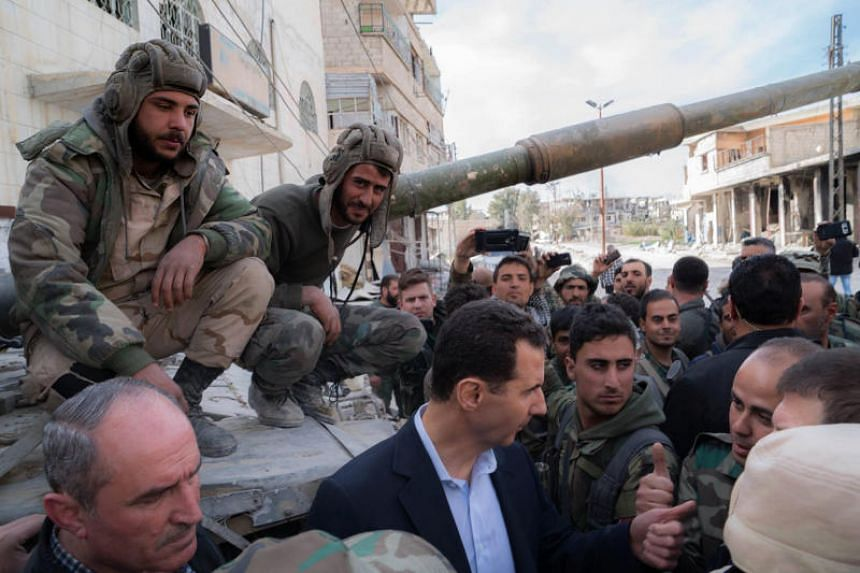 Syrian President Bashar al-Assad talking with regime forces in Eastern Ghouta on March 18, 2018.