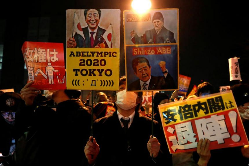 Protesters at a rally denouncing Japanese Prime Minister Shinzo Abe and Finance Minister Taro Aso over a suspected cover-up of a cronyism scandal in front of Mr Abe's official residence in Tokyo on March 14, 2018.