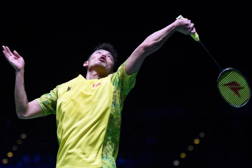China's Lin Dan plays a shot against China's Huang Yuxiang during the men's semi-final of the All England Open Badminton Championships in Birmingham on March 17, 2018.